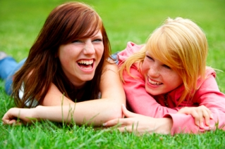 Teenage friends laughing on grass sm Jael Strauss can't make it as a model so she becomes a meth addict.